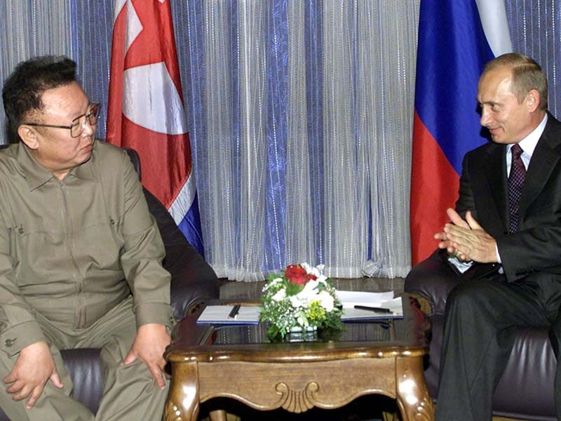 Russian President Vladimir Putin (R) speaks with his North Korean counterpart Kim Jong-il during the..